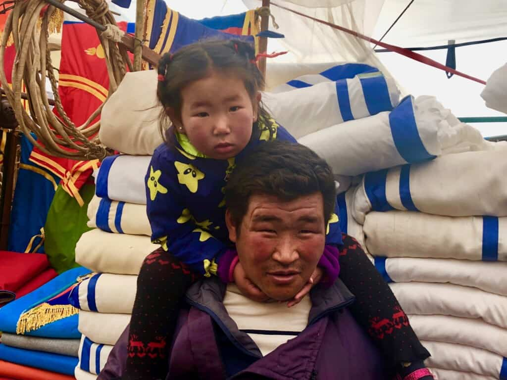 Nomadic herder and his daughter, Mongolia