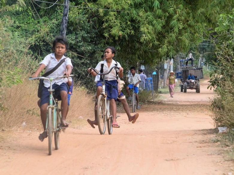 Cambodian children cycling from school