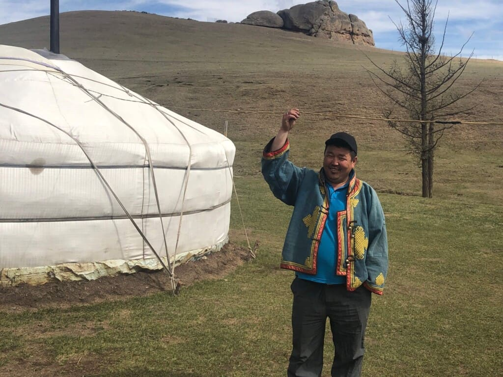 A Mongolia Herder Outside His Ger (Yurt)