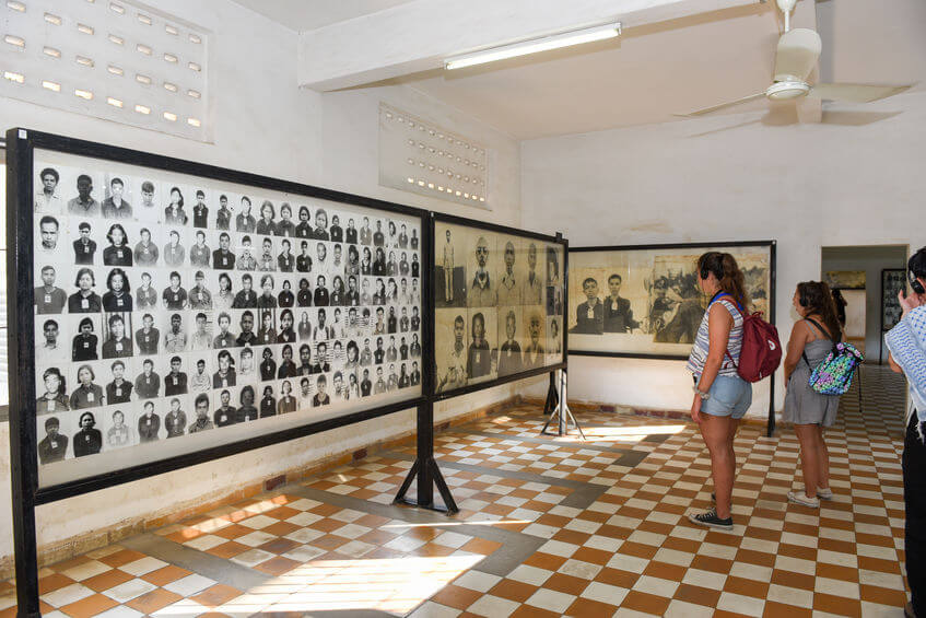 People at Tuoi Sleng Museum seeing the photos of victims